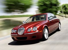 Jaguar S-Type, superb car, great fun to drive, went on a road trip from Manchester and back again via the highlands of Scotland...never mised a beat.