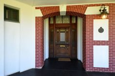 """Front door - with the """"National Monument"""" plaque (bestowed on the house in to its right. Ghost House, New Hospital, Pretoria, Victorian Fashion, Castle, Explore, Building, Outdoor Decor, History"""