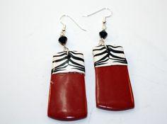 Red earrings with zebra.