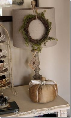 Cute idea....hang a small wreath from the lamp