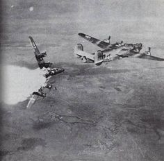 "A heavy US B-24 ""Liberator"" bomber takes a direct hit off German flak and breaks apart, Germany 1943"