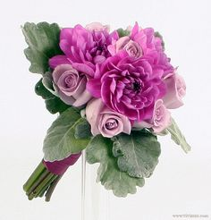 Bridesmaid bouquet of lavender and purple roses and dahlias with velvety leaves.