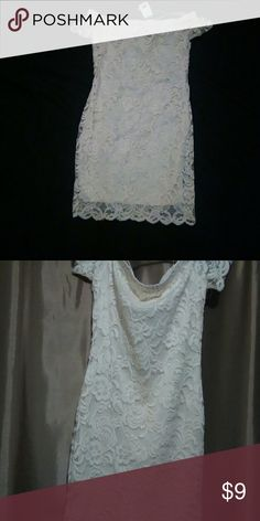 Small NWT Ivory Dress Perfect for Christmas This  Simple yet elegant dress is perfect for a cocktail party or wedding.  The polyester dress is overlain with cream lace. Ambiance Dresses Mini