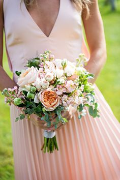 Lauren Brown Photography We're swooning over this pretty bridesmaid bouquet filled with roses, stock, blushing bride proteas, and greenery. Venue: Rainbow Ranch Lodge Floral Design:
