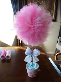 DIY tulle ball and pom poms. Would be cute with minnie mouse ears on them