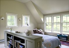 This room divider works as a headboard and a storage unit. Love the bed middle of room idea facing the window