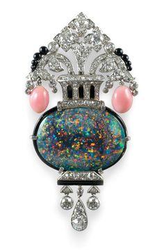 An Art Deco opal, conch pearl and diamond brooch