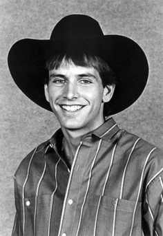 ain't he cute? and one of the best bullriders of all time....(lane frost)