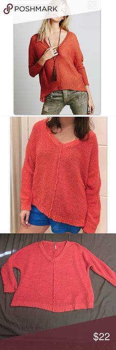 Free people sweater Re-posh. Not my color. Size medium. Beautiful coral color. Size medium. Gently used. Free People Sweaters V-Necks
