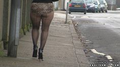 Public pantyhose video - sexy wife in seamed fishnet tights walking down street in ass revealing mini skirt and heels.