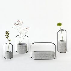Simple, minimalist Weight Vase features a stand made of thin steel to hold the flower straight and a concrete base to hold water.