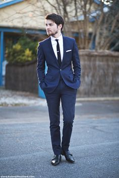Handsome groomsmen in a simple navy suit and skinny black tie. Navy and black can SO work together!