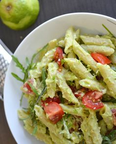 Avocado Pasta-200 g pasta 2 ripe avocados 2 cloves of garlic 1 lime basil 6-8 cherry tomatoes Handful of rocket Salt and pepper