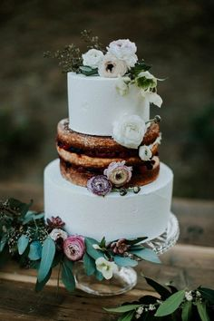 Stunning partially naked wedding cake | Image by Jessie Schultz Photography