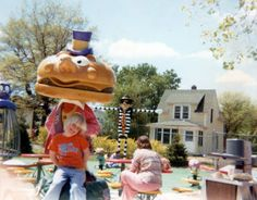 In some amazing McDonaldland nostalgia, blogger olenfoto shares this rare image from a McDonald's playland. The blogger's family members stand with the Mayor McCheese statue, amidst Fry Gobblin and Filet-O'-Fish bouncer spring toys, the 80s-version Hamburglar Swing, and the Grimace Bounce & Bend!