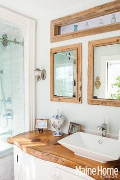 I love the detail window above the mirrors, and the natural wood vanity top.