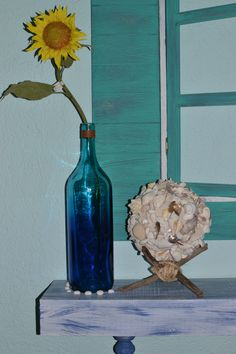 shells orb and blue glass bottle decor. Rustic simple decor. Beach house.  Nautical style. Coastal living. Vintage apartment.