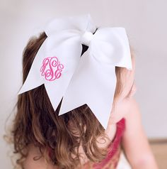 The sweetest accessory for girls of all ages... the icing on the cake! Grosgrain ribbon bow with monogrammed tail available in nine colors and many thread colors and fonts. You'll need a couple of these for special occasions, team spirit, holidays or everyday! Attaches with an alligator clip for ease and versatility.