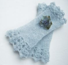"knitted ""wrist"" warmers with crocheted lace at the ends."