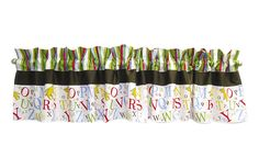 Add the finishing touch to your nursery with this Dr. Seuss ABC Window Valance by Trend Lab. Cotton valance features a variegated stripe print in barn red, avocado, cornflower blue, mango orange and c