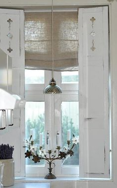 shutters and roman blind