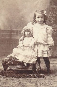 Little Girl With Porcelain Doll - back in the day dolls were very important to little girls.