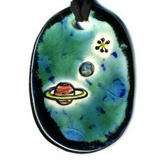 RInged Planet and a Moon Ceramic Necklace in Black and by surly, $18.00