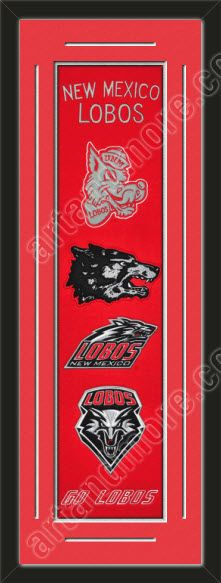 This framed University of New Mexico heritage banner, double matted in team colors to 12 x 36 inches.  The lines show the bottom mat color.  $139.99 @ ArtandMore.com