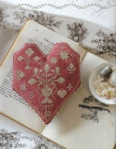 From BLACKBIRD DESIGNS My Dear Hearts. Counted Cross Stitch Pattern of Reproduction Sampler, Sweetheart Pincushion, Flowers, Urns, Generation Sampler. ** PATTERN ONLY ** FABRIC: 36 ct Ale linen, Sampler; 36 ct Tango linen, Heart STITCH COUNT: 137w x 177h; approximate Sampler design size, 7 3/4 x 10; 93w x 105h; approximate Pincushion design size, 5 1/4 x 6 WDW: Bright Leaf, Dolphin, Fawn, Gold, Moss (2 skeins), Red Rocks (2 skeins)--Sampler; Fawn, Sandcastle--Pincushion --- FULL ...