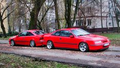 Opel Calibra. Two of them. Mirrored