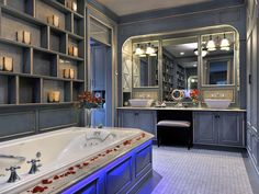 The distressed blue walls and cabinetry in this master bath by Ken Kelly are a replication of French country cabinetry prevalent in southern France during the 18th century. Piped-in music and a flat screen television mounted behind a tempered two-way mirror make the space modern. Traditional Bathroom, Beautiful Bathrooms, Dream Bathrooms, Master Bathrooms, Romantic Bathrooms, Luxury Bathrooms, Rustic Bathrooms, Bathroom Mirrors, French Bathroom
