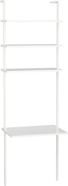 height of white.  Minimalism scales to the max in clean, pristine white.  Sleek desktop surface and three shelves ladder sky high (a CB2 record high at 8 feet) in engineered wood with glossy lacquer.  Slick powdercoated aluminum frame with hidden hardware accentuates spotless rise of white.  Mounts sturdy to the wall.  Create a vertical library with stairway white wall-mounted bookcase.