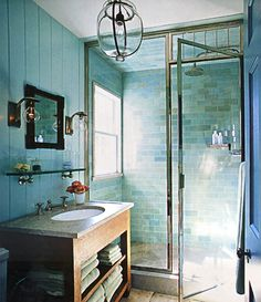 Bathroom - shower with turquoise tile walls, turquoise paneling, tan floor - Interior Designers: Steven Gambrel and Chris Connor - Photographer: Tim Street-Porter - The World of Interiors, December 2008