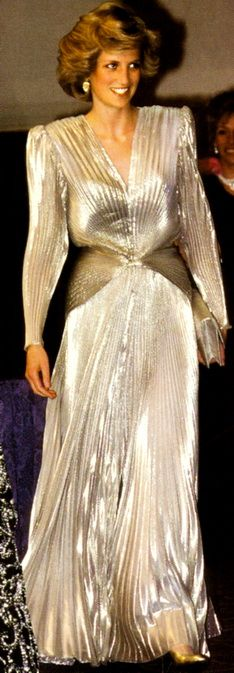 Silver, shimmering gown with an exposed back designed by Bruce Oldfield. Diana wore this gown in March 1985 for a fashion show gala to aid Dr. Barnado's Charity, of which she was president.