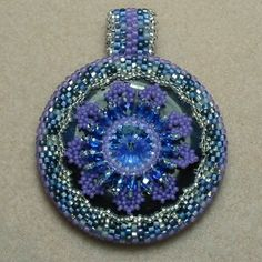 Free Pattern: Flowered Donut Pendant by Sabina Anderson featured in Bead-Patterns.com Newsletter!