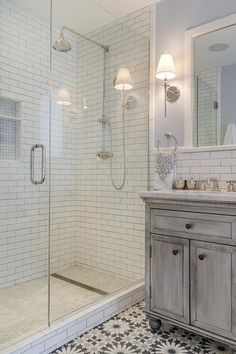 Fabulous bathroom features a gray distressed washstand, Restoration Hardware Annecy Metal-Wrapped ...