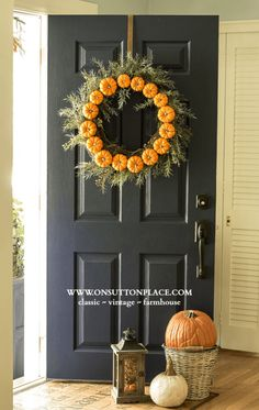"Hay bales and pumpkins aren't just for your porch—you can hang them on your door, too! Try making a DIY wreath that you can hang year after year by using faux pumpkins. Get the tutorial at On Sutton Place. What you'll need: 18"" wire wreath frame ($3, amazon.com); Mini pumpkins ($10 for 10, amazon.com)"