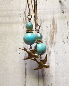 These earrings will complete your look. Turquoise adds the perfect pop of color ~Turquoise beads ~Czech Beads ~Brass Spacers ~Hand forged ear wires in brass ~Brass Sparrow Length 2 1/2 inches