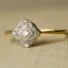 i LOVE antique rings... and yes, i would rather have the history over the tiffany's... weird, right?