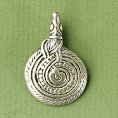Viking Age silver pendant depicting a coiled serpent from Orebro, Sweden (Orebro County Museum CC BY-NC 4.0)