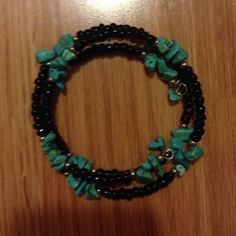 Turquoise bracelet Stretchy wrap black & turquoise bracelet. Excellent condition. Never worn. Jewelry Bracelets