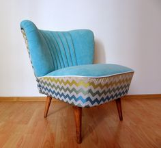 Classic lounge chair covered with zig-zag style upholstery fabric. Basic from 1970.