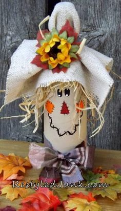 A quick and easy craft project for an Upcycled Wine Bottle Scarecrow by Cyndee Kromminga from Restyled Junk. The wine bottle decor is perfect for Halloween.Wine For Sale Online Refferal: wining tips! Fall Wine Bottles, Halloween Wine Bottles, Wine Bottle Art, Painted Wine Bottles, Wine Bottle Crafts, Mason Jar Crafts, Decorated Bottles, Diy Bottle, Scarecrow Crafts
