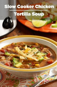 A slow cooker chicken tortilla soup recipe with chicken thighs, Southwest mixed vegetables, zesty tomatoes, spices and fresh lime juice