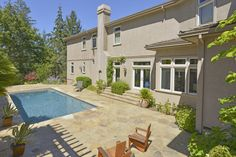 Swimming pool with outdoor kitchen and fireplace in Napa Valley. Additional photos and information at http://naparealestatematch.com/listing/1819-foothill-blvd-calistoga-ca/