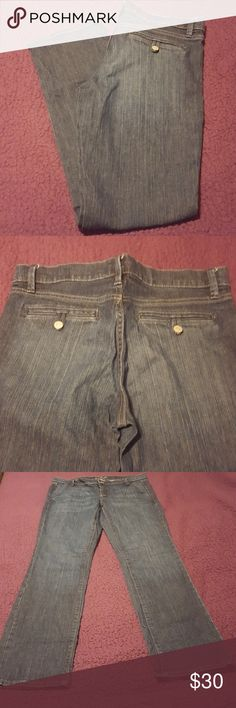 Dark wash Old Navy Jeans BNWOT These are brand new, never worn. The Flirt jeans by Old Navy. Loop and button closure pockets in the back and slit pockets in the front. Smoke free and pet friendly home. Bundle to save on shipping and get 10% off. Happy Poshing! Old Navy Jeans Straight Leg
