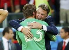 Tim Krul of the Netherlands is hugged by coach Louis van Gaal after making the match winning penalty save in their shootout against Costa Rica during their 2014 World Cup quarter-finals at the Fonte Nova arena in Salvador July 5, 2014. REUTERS/Sergio Moraes
