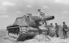 German Soldiers inspecting a captured SU-152 Soviet Self-Propelled Gun.