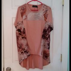 """Evil Twin Hi Low Oversized Top This top is NWT! It is a pink color with beautiful designs on the front yoke and front sides. The colors are browns, white, and purples. It is approximately 27"""" across the bust when laid flat. It is approximately 25 1/2"""" from shoulder to hem at the shortest point and 34"""" at the longest point. It is 75% rayon, 20% polyester, 5% elastane. Lining:  80% polyester, 20% elastane   Contrast:  100% polyester ✋PRICE IS FIRM ✋ Evil Twin Tops"""