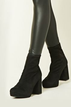 0fe2257ae9c A pair of faux suede sock boots featuring a block heel and a round toe.